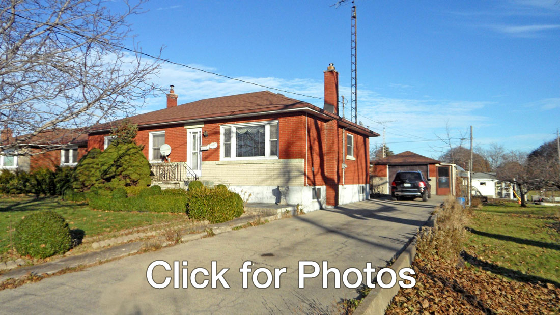 picture of brick bungalow and detached garage at 407 Steele Street Port Colborne